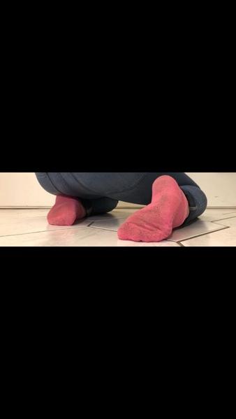 Füße kitzelten die Strümpfe