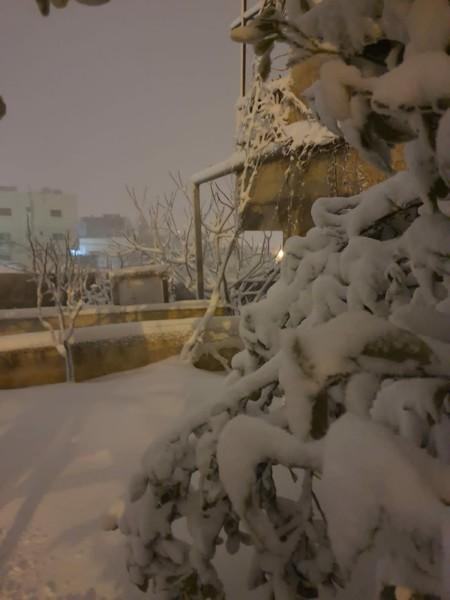 صوركم او صور مناطقكم بالثلج